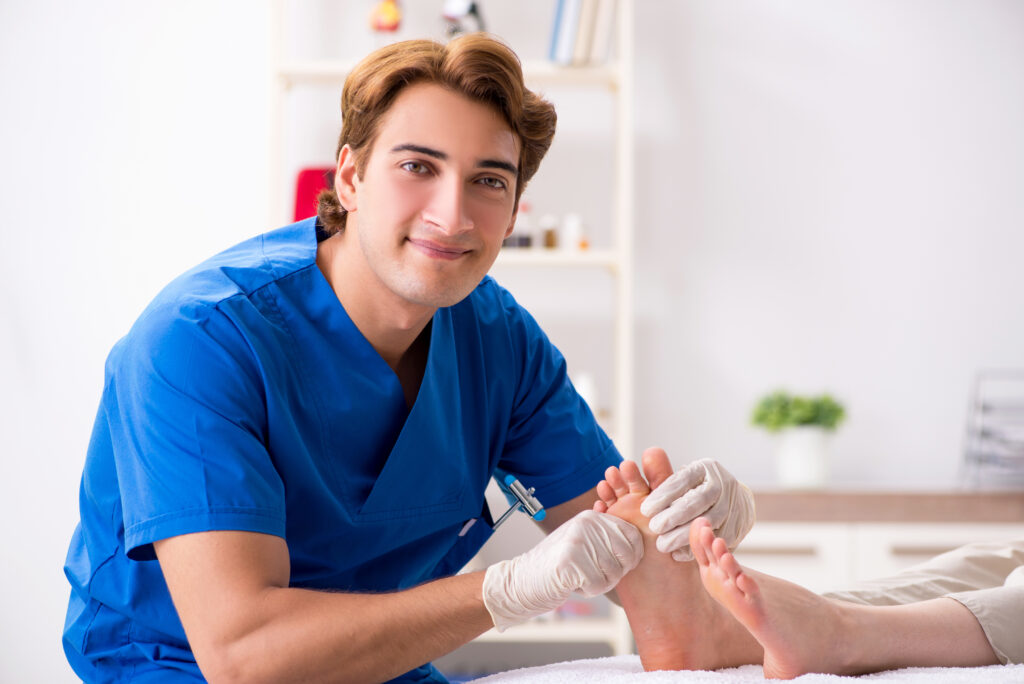 Doctor examining patient feet