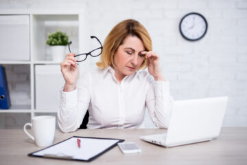 Woman stressed out at the office